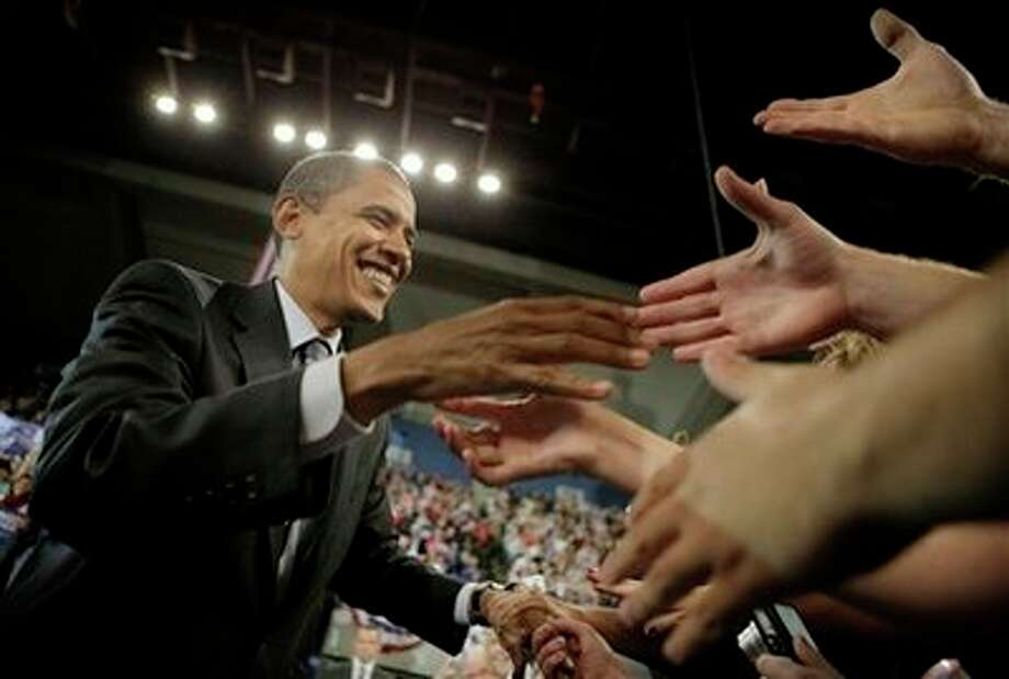 Democratic presidential candidate, Sen. Barack Obama, D-Ill., shakes hands with supporters at a rally in Roanoke, Va., Friday, Oct. 17, 2008. Photo: Jae C. Hong, AP / AP
