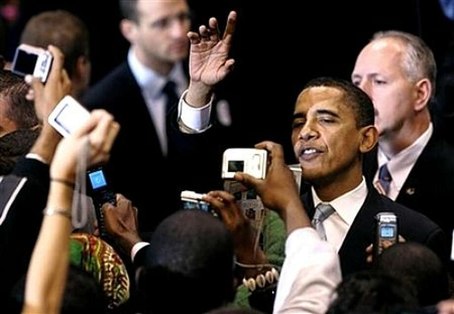 Democratic presidential hopeful Sen. Barack Obama, D-Ill., right, gestures to supporters during his campaign rally in East Rutherford, N.J., Monday, Feb. 4, 2008, in the final campaign push before Super Tuesday. Photo: Mike Derer, AP / AP
