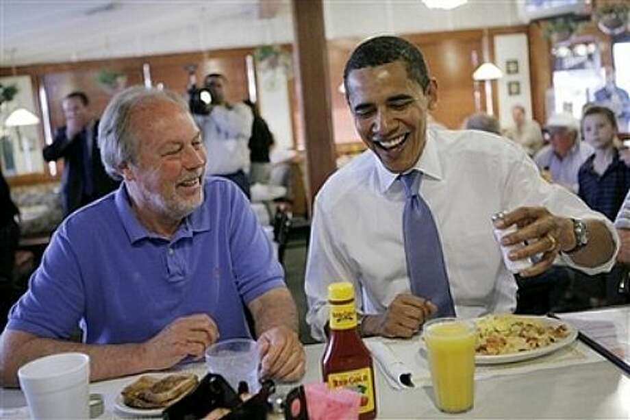 Democratic presidential hopeful, Sen. Barack Obama, D-Ill., right, and Rick Jones, 59, chat while eating breakfast at Four Seasons Family Restaurant in Greenwood, Ind., Tuesday, May 6, 2008, as voters in both Indiana and North Carolina crowd polling places Tuesday for the states' primary elections. . Photo: Jae C. Hong, AP / AP