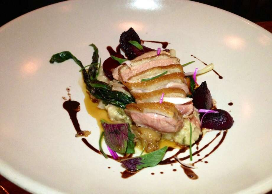 Duck on oatmeal with beets, ramps and chocolate