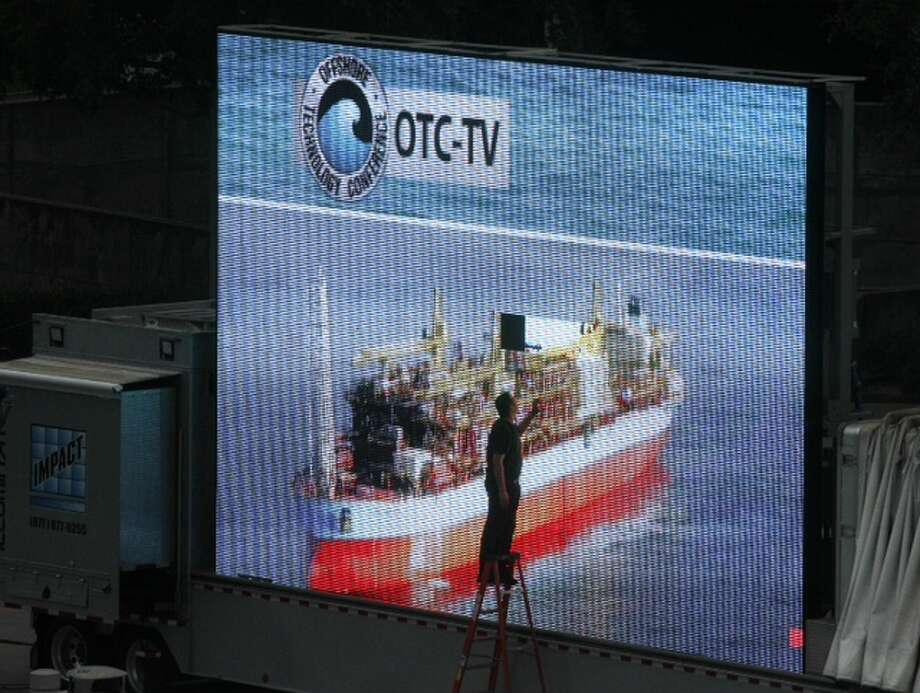 A video board for OTC-TV is worked on before the start of the final day of the Offshore Technology Conference at Reliant Park Thursday, May 9, 2013, in Houston. ( Brett Coomer / Houston Chronicle )