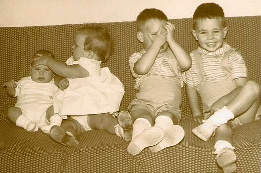I knew I was a mom when I tried to get a picture of all four children to send to the grandparents. We were a military family living on base in Oscoda, Michigan. This was 50 years ago, in 1963, a few months after Michael, child No. 4, was born.  Douglas, the oldest at 3, was the only one who knew how to smile for a photo. Daniel, age 2  was obviously out of sorts, and Stephanie, 18 months,  just wanted to get rid of that little baby brother who was stealing her thunder! If a picture can reveal what my life was like as a mother at that stage   this is it!