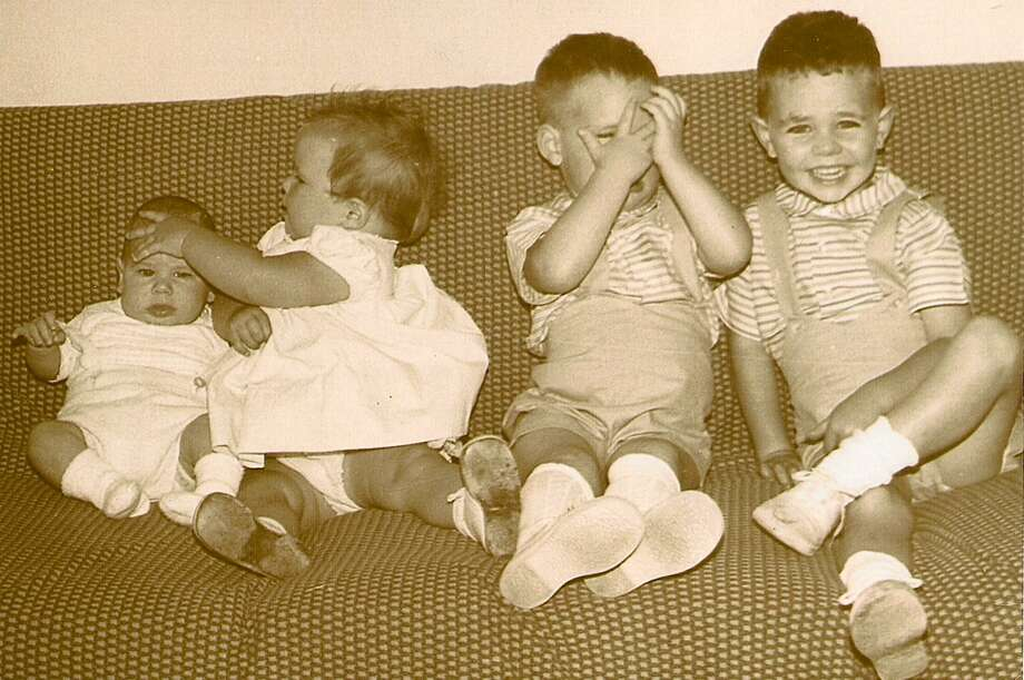 I knew I was a mom when I tried to get a picture of all four children to send to the grandparents. We were a military family living on base in Oscoda, Michigan. This was 50 years ago, in 1963, a few months after Michael, child No. 4, was born.  Douglas, the oldest at 3, was the only one who knew how to smile for a photo. Daniel, age 2  was obviously out of sorts, and Stephanie, 18 months,  just wanted to get rid of that little baby brother who was stealing her thunder! If a picture can reveal what my life was like as a mother at that stage   this is it! Marlene Richardson Photo: Richardson Reader Submission
