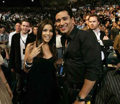 Eva Longoria, left, and Mario Lopez attend at the Oscar De La Hoya and Floyd Mayweather Jr. boxing match on Saturday, May 5, 2007, at the MGM Grand Garden Arena in Las Vegas. Floyd Mayweather Jr. won by split decision. Photo: Kevork Djansezian, AP / AP