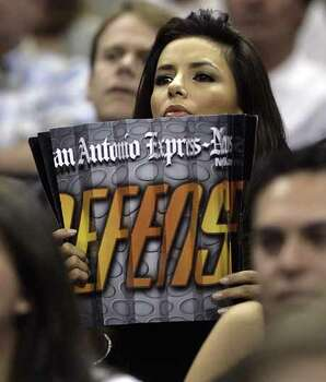 SPORTS     -----    Eva Longoria holds an Express-News give-away item Saturday night May 12, 2007 at the AT&T Center in San Antonio during the Spurs' third game of their best-of-seven, second-round playoff series against the Suns.         (WILLIAM LUTHER/STAFF) Photo: WILLIAM LUTHER, SAN ANTONIO EXPRESS-NEWS / SAN ANTONIO EXPRESS-NEWS