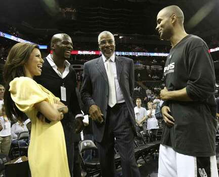 "Spurs' Tony Parker, right enjoys a laugh with NBA Legend, Julius ""Dr. J"" Erving, second from right and Parker's fiancee Eva Longoria prior to the NBA Finals game one in San Antonio Thursday June 7, 2007. Other man is not identified. (TOM REEL/STAFF) Photo: TOM REEL, SAN ANTONIO EXPRESS-NEWS / SAN ANTONIO EXPRESS-NEWS"