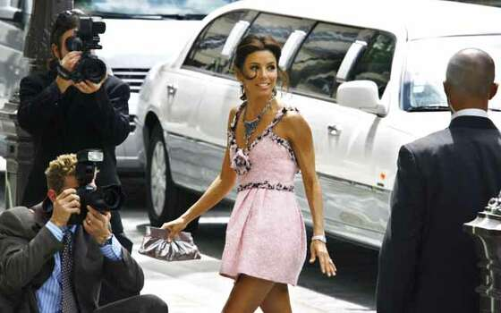 "U.S. actress Eva Longoria, a star on the U.S. television series ""Desperate Housewives,"" arrives at a Paris City Hall, Friday, July 6, 2007, for her civil wedding with NBA player Tony Parker. The religious wedding is expected to be celebrated on Saturday July 7, 2007, followed by a reception planned at a historic chateau outside Paris. (AP Photo/Michel Spingler)  Headline: Eva Longoria Photo: MICHEL SPINGLER, AP / AP"
