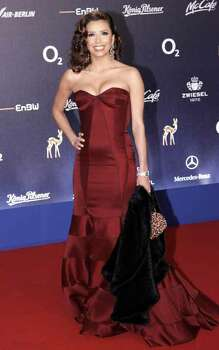 "U.S. actress Eva Longoria poses for the photographers on the red carpet prior to the  ""Bambi"" media award ceremony in Duesseldorf, western Germany, Thursday, Nov. 29, 2007. Photo: Miguel Villagran, AP / AP"
