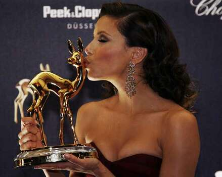 US actress Eva Longoria displays her  Bambi entertainment award at a photocall during the award ceremony in Duesseldorf, western Germany, Thursday, Nov. 29, 2007. Longoria was awarded with the media in the category TV-series international. Photo: Hermann J. Knippertz, AP / AP