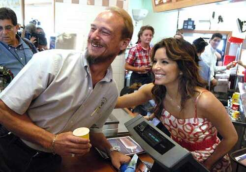 "Actress Eva Longoria-Parker poses with resident Benny Bennett as she works behind the counter at the Wendy's Old Fashioned Hamburgers restaurant in Corpus Christi, Texas,  on Tuesday, May 27, 2008, during a publicity campaign for the second annual ""Father's Day Frosty Weekend."" The goal is to raise more than $1.3 million for the Dave Thomas Foundation for Adoption and the Wendy's Wonderful Kids Foundation. Photo: Paul Iverson, AP / AP"