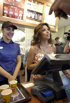 "Actress Eva Longoria-Parker stands with employee Brooke Northcott, left, as she works behind the counter at the Wendy's Old Fashioned Hamburgers restaurant in Corpus Christi, Texas,  on Tuesday, May 27, 2008, during a publicity campaign for the second annual ""Father's Day Frosty Weekend."" The goal is to raise more than $1.3 million for the Dave Thomas Foundation for Adoption and the Wendy's Wonderful Kids Foundation. Photo: Paul Iverson, AP / AP"