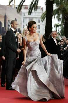 American actress Eva Longoria Parker and husband French basketball player Tony Parker, background left, arrive for the screening of the film 'Bright Star' during the 62nd International film festival in Cannes, southern France, Friday, May 15, 2009. Photo: FRANCOIS MORI, AP / AP