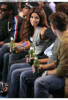 Actress Eva Longoria Parker sits courtside during the shoot for her new Heineken Light television ad set to debut in the United States on July 1, 2009. More behind-the-scenes footage will be available online at YouTube.com/HeinekenUSA. Credit:  Marcus Lynam/AP for Heineken USA. Photo: Marcus Lynam, AP FOR HEINEKEN USA / HO
