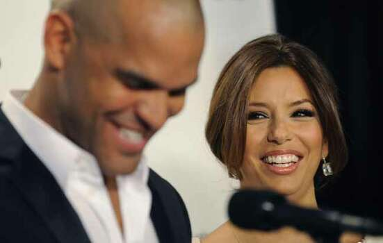 "Presenter Eva Longoria Parker, right, reacts as fellow presenter Amaury Nolasco announces her as a nominee for Actress in a Television Comedy for ""Desperate Housewives,"" during the nominations for the 2009 ALMA Awards in Los Angeles, Tuesday, Aug. 25, 2009. The show will be taped on Sept. 17 in Los Angeles. Photo: Chris Pizzello, AP / AP"