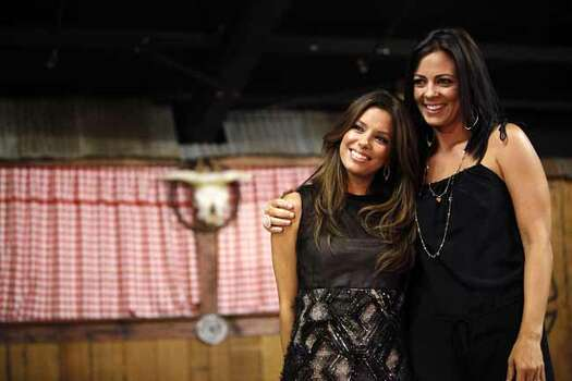 "Metro - Eva Longoria Parker poses with Sara Evans during the 2nd annual Tony & Eva Parker Clebrity Casino Night, an event for her charity,  ""Eva's Heroes,"" which benefits developmentally challenged young people, at Pedrotti's North Wind Ranch, Saturday, September 12, 2009. SHAMINDER DULAI/sdulai@express-news.net Photo: Shaminder Dulai, San Antonio Express-News / sdulai@express-news.net"