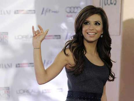 Actress Eva Longoria Parker waves to photographers at The Hollywood Reporter's Annual Women in Entertainment Breakfast in Beverly Hills, Calif., Friday, Dec. 4, 2009. Photo: AP