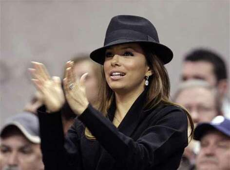 Actress Eva Longoria cheers during an NBA basketball game between the Minnesota Timberwolves and San Antonio Spurs in San Antonio, Tuesday, Dec. 29, 2009. Photo: Eric Gay, AP / AP