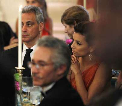 White House Chief of Staff Rahm Emanuel, left, is seated with actress Eva Longoria Parker as President Barack Obama and first lady Michelle Obama host Mexican President Felipe Calderon and Mexico's first lady Margarita Zavala for the State Dinner at the White House in Washington, Wednesday, May 19, 2010. Photo: Charles Dharapak, AP / AP
