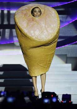 Host Eva Longoria, wearing a costume depicting a leg of ham, presents at the MTV European Music Awards 2010, in Madrid, Sunday, Nov. 7, 2010. Photo: AP