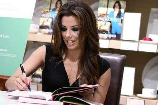 "Eva Longoria signs copies of her first cookbook, ""Eva's Kitchen: Cooking with Love for Family and Friends"", June 4, 2011, at Williams-Sonoma at the Shops at La Cantera.  ANDREW BUCKLEY / abuckley@express-news.net Photo: ANDREW BUCKLEY, SAN ANTONIO EXPRESS-NEWS / SAN ANTONIO EXPRESS-NEWS"