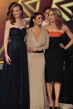 "Marcia Cross, Eva Longoria and Felicity Huffman get playful when ""Desperate Housewives"" wins the ALMA for ""Favorite TV Series."" Photo: NBC"