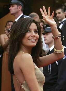 "American actress Eva Longoria, waves as she arrives for the screening of""Where the Truth Lies"", shown in competition at the 58th international Cannes film festival in Cannes, southern France, Friday May 13, 2005. Photo: MICHEL EULER, AP / AP"
