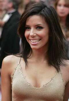 "American actress Eva Longoria, smiles as she arrives for the screening of""Where the Truth Lies"", shown in competition at the 58th international Cannes film festival in Cannes, southern France, Friday May 13, 2005. Photo: MICHEL EULER, AP / AP"