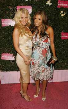 Actresses Eva Longoria, right, and Jessica Simpson arrive for the T-Mobile Sidekick 3 launch party in Los Angeles, Tuesday, June 20, 2006. Photo: LUCAS JACKSON, AP / AP
