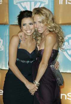 Eva Longoria, left, and Sheryl Crow clown around as they arrive for the In Style and Warner Bros. party following the 64th Annual Golden Globe Awards on Monday, Jan. 15, 2007, in Beverly Hills, Calif. Photo: Mark J. Terrill, AP / AP