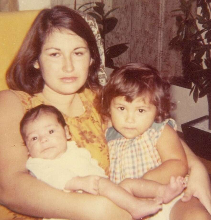 I knew I was a mom when I first separated from my first born Ana, a month after her birth. This separation was very significant to me because I discovered that we would forever be connected. Though we were physically apart, my mind had a direct line to her - later to my other children. At times, we have psychic communication and I even feel their pain. One time, Eva had a minor accident and I could feel some of her pain, to the point where we both got medical treatment. Last Sunday, I texted Ana twice, when she called me at the same time. All my children, Ana, Eva, Isa, and Nicky all have psychic lines to me, like I had to my mother. She was like a conscience to me. Being a mom is a loving, eternal invisible tie. Rosa Flores Fernandez holding Ana and Eva, Corpus Christi, 1972 Photo: Fernandez - Reader Submission