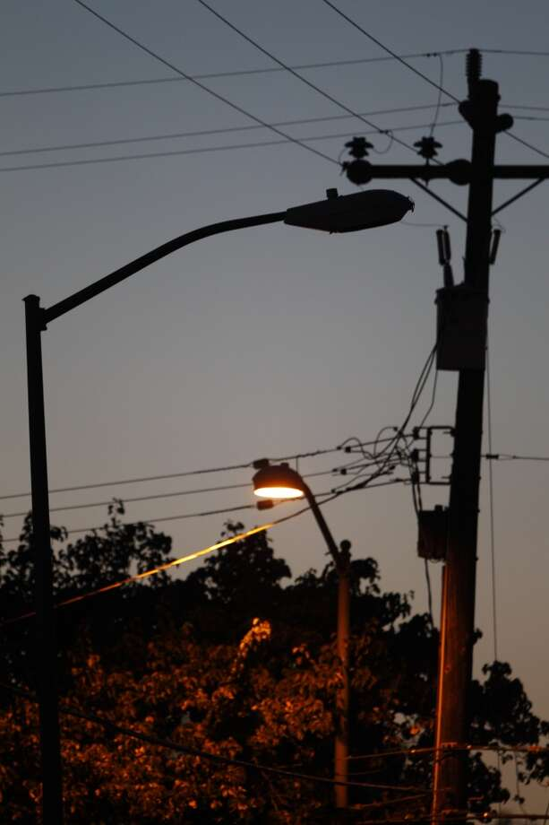 A nonfunctioning streetlight near a working one at the intersection of Hawley Street and 75th Avenue. Streetlights near the intersection of Hawley Street and 77th Avenue in Oakland, Calif., were barely working on Tuesday, May 7, 2013. On 77th Avenue near the intersection, only 3 in 10 were operational and on Hawley, only one of the three was functioning.