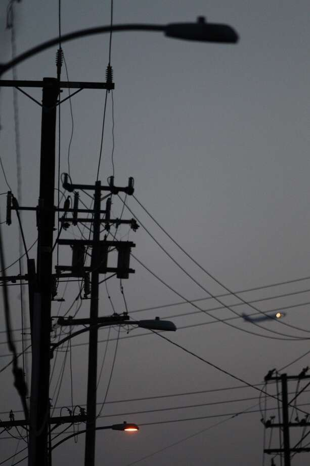 Streetlights near the intersection of Hawley Street and 77th Avenue in Oakland, Calif., were barely working on Tuesday, May 7, 2013. On 77th Avenue near the intersection, only 3 in 10 were operational and on Hawley, only one of the three was functioning.