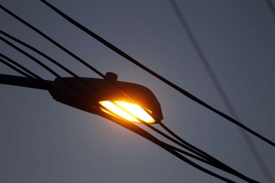 One of the few working streetlights near the intersection of Hawley Street and 77th Avenue in Oakland, Calif., on Tuesday, May 7, 2013. On 77th Avenue near the intersection, only 3 in 10 were operational and on Hawley, only one of the three was functioning.