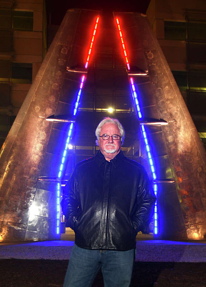 Artist Bill FitzGibbons poses Tuesday night Dec. 17, 2008 in front of one of the pieces of public art he created at the San Antonio International Airport. Photo: WILLIAM LUTHER, SAN ANOTNIO EXPRESS-NEWS / SAN ANTONIO EXPRESS-NEWS