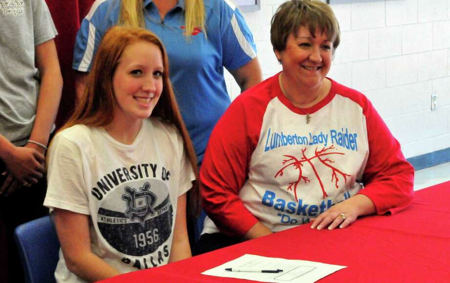 Lumberton High School Senior Caitlyn Worry signed with the University of Dallas on Wednesday to play basketball.  Cassie Smith/The Beaumont Enterprise Photo: Cassie Smith