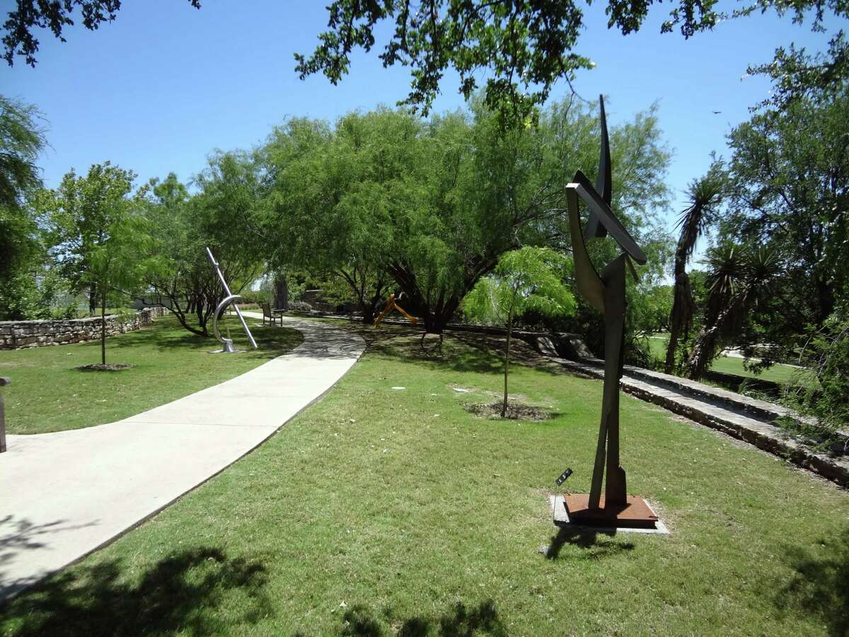 Contemporary sculpture along the San Antonio Botanical Center acequia is part of Art in the Garden, a collaboration with the Blue Star Contemporary Art Museum.