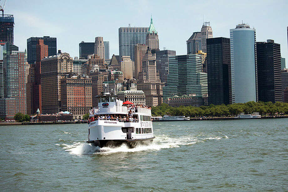 A Statue Cruises ferry leaves Manhattan's Battery Park for a tour of Liberty and Ellis islands.