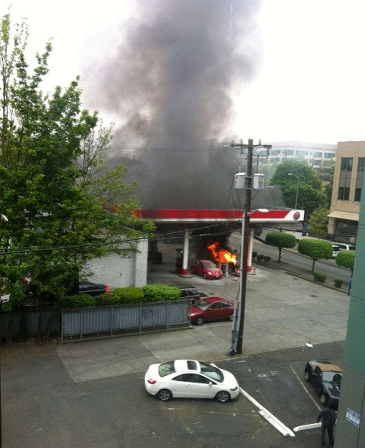 A pump at a 76 gas station burns at Terry Avenue and James Street on Thursday, May 9, 2013.