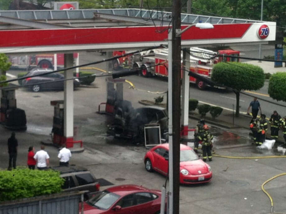 A pump at a 76 gas station burns at Terry Avenue and James Street on Thursday, May 9, 2013. Photo: Courtesy Photo / @Seattle_12s