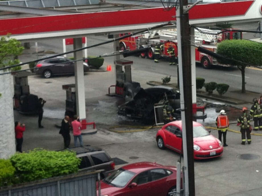 A pump at a 76 gas station burns at Terry Avenue and James Street on Thursday, May 9, 2013. Photo: @Seattle_12s, Courtesy Photo / @Seattle_12s