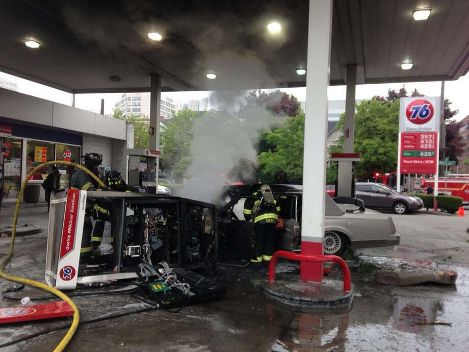 The scene is shown after a car crashed into a pump at a 76 gas station at Terry Avenue and James Street on Thursday, May 9, 2013. Photo: Courtesy Photo / @SeattleFire