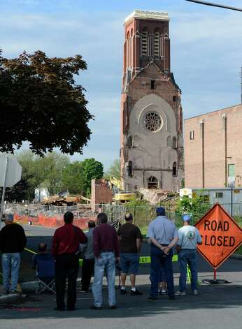 Bystanders gather to watch workers prepare to remove the top 30 feet of the remaining portion of St. Patrick's Church May 9, 2013 in Watervliet, N.Y.   (Skip Dickstein/Times Union) Photo: SKIP DICKSTEIN / 00022323A