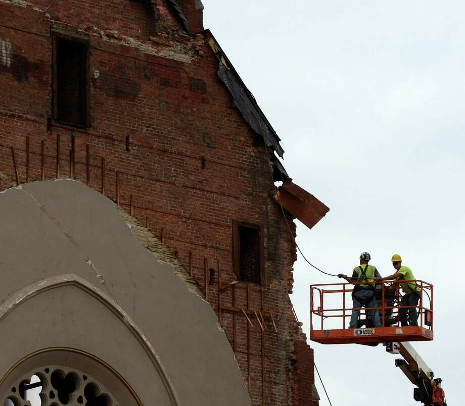 Workers prepare to remove the top 30 feet of the remaining portion of St. Patrick's Church May 9, 2013 in Watervliet, N.Y.   (Skip Dickstein/Times Union) Photo: SKIP DICKSTEIN / 00022323A
