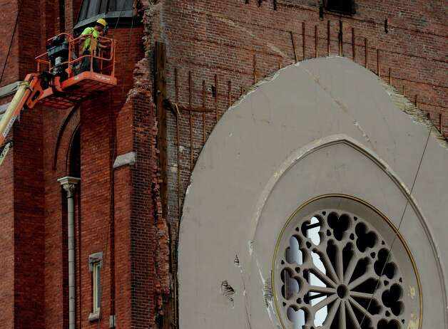 Workers prepare to remove the top 30' of the remaining portion of St. Patrick's Church May 9, 2013 in Watervliet, N.Y.   (Skip Dickstein/Times Union) Photo: SKIP DICKSTEIN / 00022323A