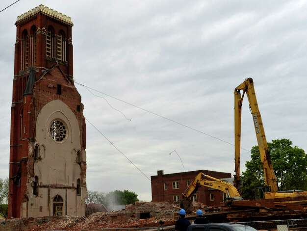 A piece of rigging breaks as workers try to remove the top 30 feet of the remaining portion of St. Patrick's Church May 9, 2013 in Watervliet, N.Y.   (Skip Dickstein/Times Unio