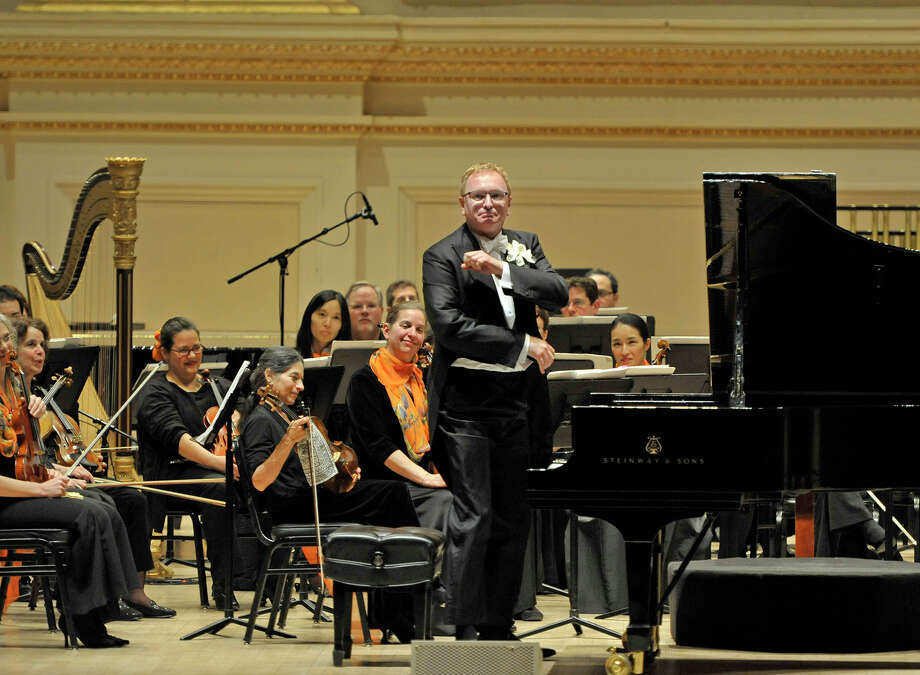 Painist Kevin Cole stands at the instrument during Tuesday, May 7, 2013, performance with the Albany Symphony Orchestra at Carnegie Hall in New York City. (Gary Gold / Albany Symphony Orchestra)
