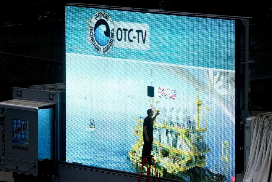 The OTC-TV video board is repaired before the start of the Offshore Technology Conference May 9, 2013 in Houston. ( Brett Coomer / Houston Chronicle ) Photo: Brett Coomer, Chronicle