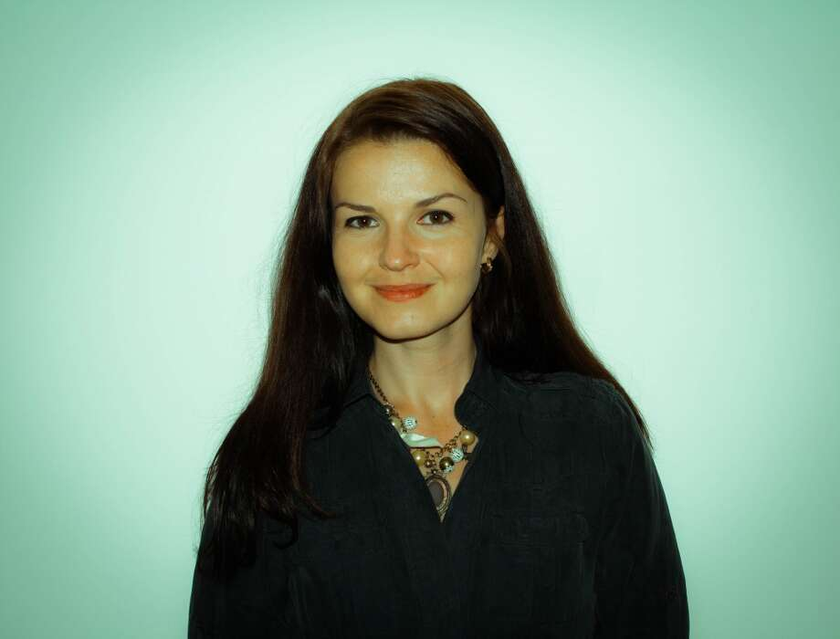 Ludmilla Buzinkvica's charm necklace, which I spotted from across a crowded room, comes from Bahrain. Which means there's no way to just run out and pick one up, unfortunately.