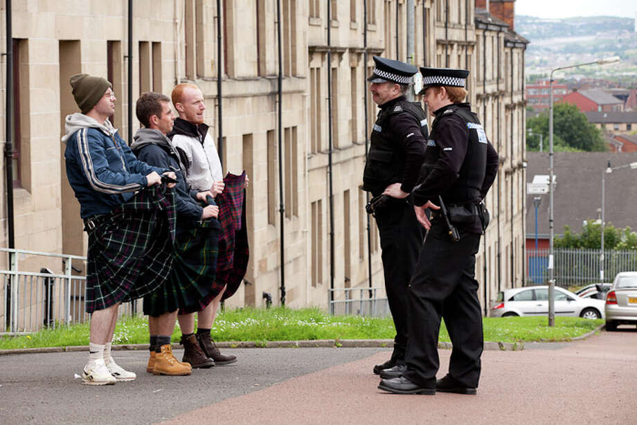 """Gary Maitland, William Ruane and Paul Brannigan give the police a quick flash in """"The Angels' Share."""" Photo: Joss Barratt, Handout / ONLINE_YES"""