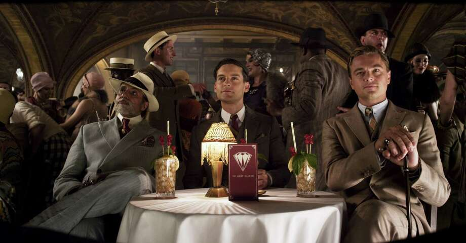 """The Great Gatsby"" comes roaring to life with the help of actors Amitabh Bachchan, from left, Tobey Maguire and Leonardo DiCaprio. Photo: Courtesy Of Warner Bros. Picture"